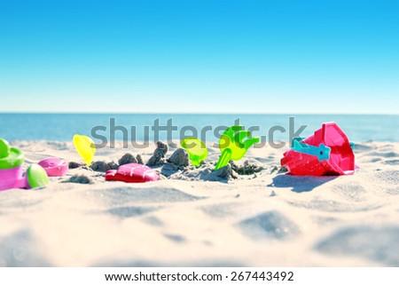 toys on the sand seashore - stock photo
