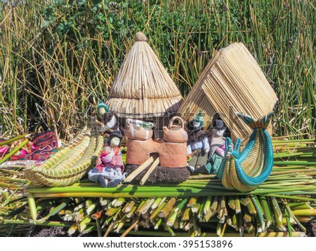Toys, Souvenirs, and handicrafts made at Uros floating island and village on Lake Titicaca near Puno, Peru - stock photo