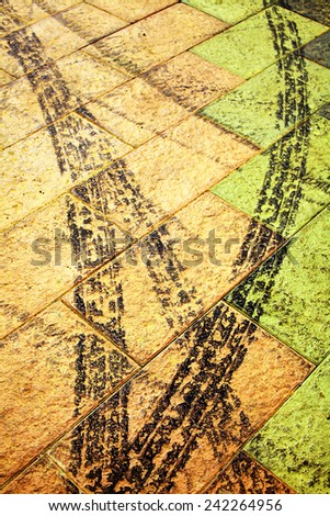 Trace from a protector of an automobile wheel on the ground. - stock photo