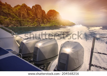 Trace motor boats on the water of a ocean - stock photo
