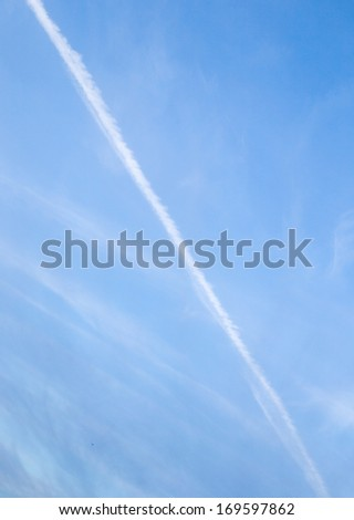 trace of a cloud from an airplane in the sky in the morning