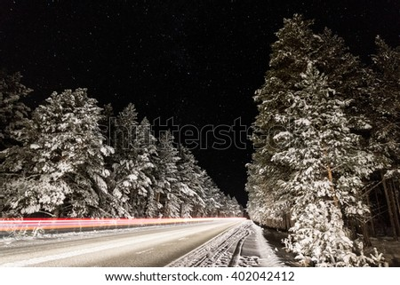 traces of cars on the shutter speed on the way to Arshan, Eastern Sayan - stock photo