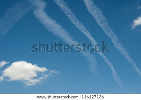 Traces of planes and clouds in the sky. - stock photo