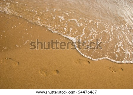 traces on the beach - stock photo