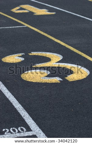 track and field numbers 3 and 4 - stock photo