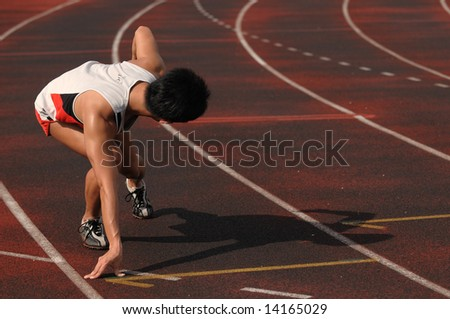 track and field sprinter ready to go - stock photo