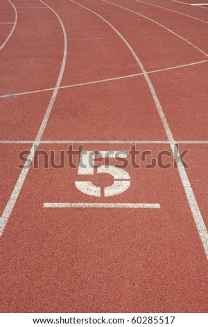 Track number five, Running track around the football field. - stock photo