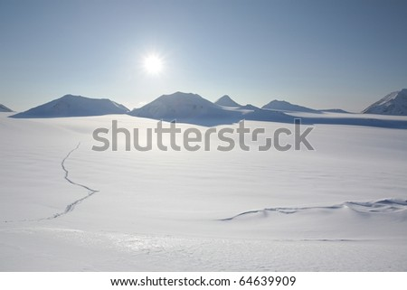 Track on the snow - winter Arctic landscape - stock photo