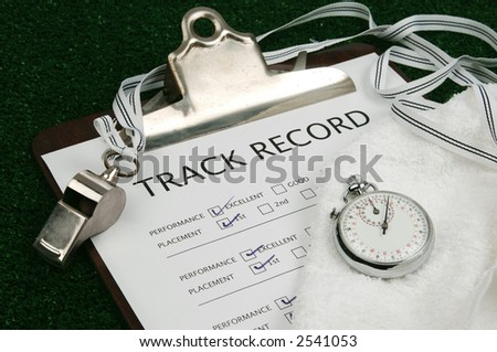 track record on clip board with stop watch, whistle and towel - stock photo
