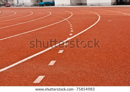 Track red and white lines divide the box for the tournament background texture - stock photo