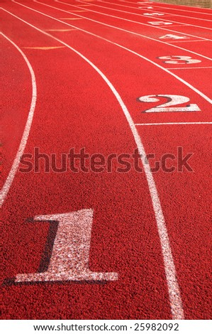 Track rounding first corner - stock photo
