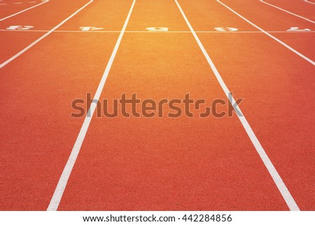 track running, Red treadmill in sport field with sunshine background. - stock photo
