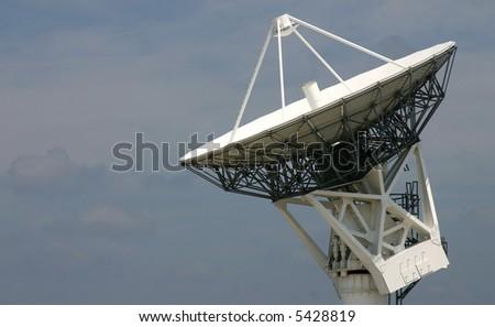 Tracking Satellite Dish against mottled sky PHOTO ID: KSCRadar00006_RJ - stock photo