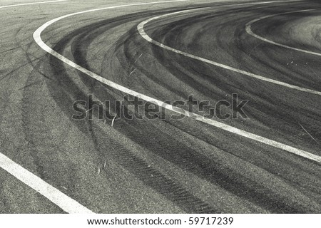 Tracks of tires on a speedway - stock photo