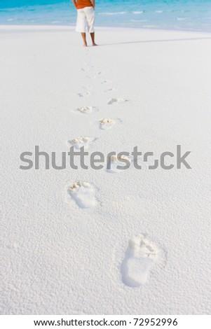Tracks on sand of wonderful tropical beach - stock photo