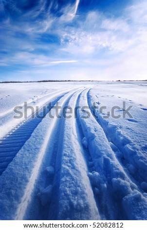 Tracks on snow - stock photo