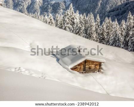 Tracks to the ski hut - stock photo