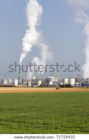 tractor and factory - stock photo