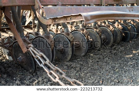 tractor and seeder planting crops on a field - stock photo