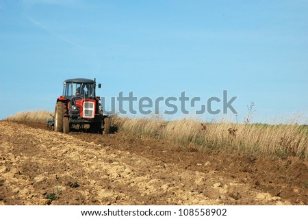 Tractor at work on a field.