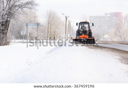 tractor cleaning the road from the snow