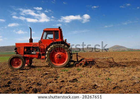 Tractor cultivating 3 - stock photo