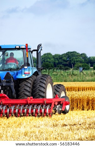 Tractor in a field, an exhibition of modern technology