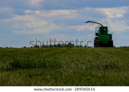 Tractor in a field for agricultural work - stock photo