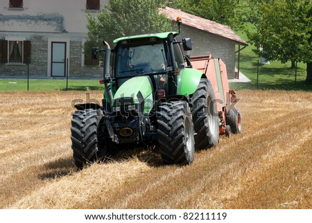 tractor in a field of freshly cut wheat