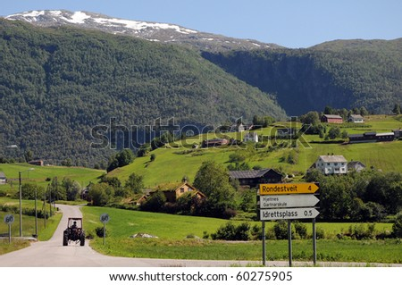 Tractor in countryside above Hardangerfjord, Norway - stock photo
