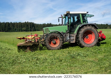 Tractor mowing meadow