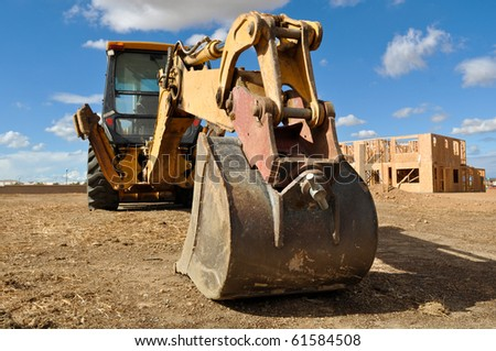 Tractor on a New Home Construction Site - stock photo