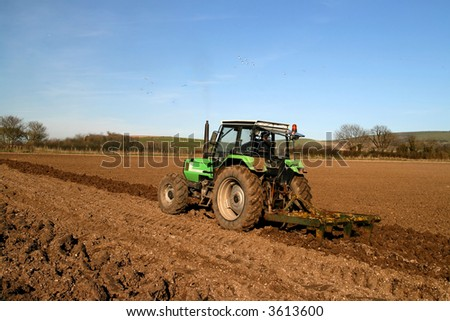 Tractor ploughing in a english field