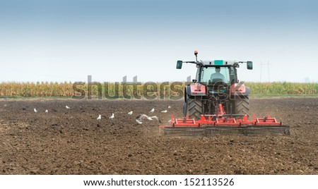 Tractor preparation in the fields - stock photo