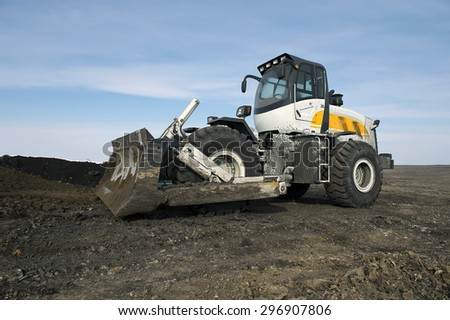 tractor, push, move, bulldozer, wheel, cabin, fraction, piece, transport, mine, minerals, digging, shipping, to walk, mine, - stock photo