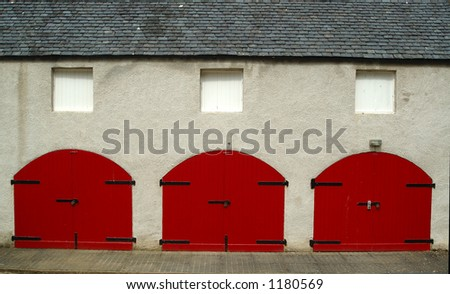 Tractor shed doors at Aden House Aberdeenshire - stock photo
