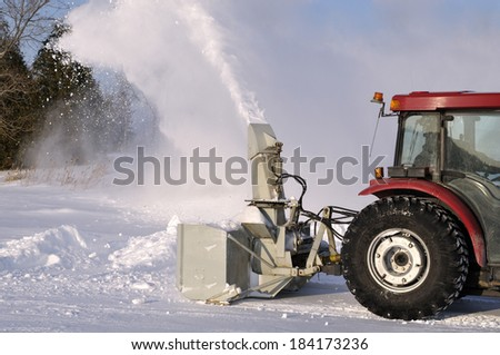 Tractor snow blower after a snowstorm - stock photo