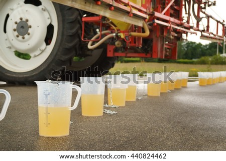 Tractor spray nozzle adjustment for pesticide fungicide insecticide sprayer - stock photo