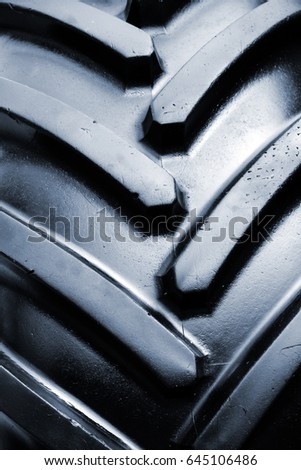 Tractor tire detail, close up of agricultural machinery rubber tyre