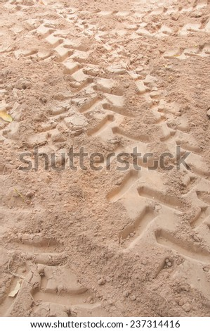 Tractor trail closeup on the ground - stock photo