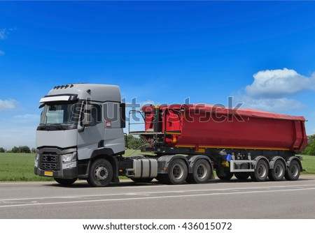 "tractor trailer truck on background of trees of ""Trucks"" series in my portfolio - stock photo"