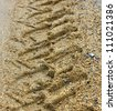 Tractor wheel tracks in the sand - stock photo