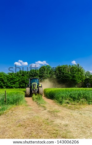 Tractor with baler - stock photo