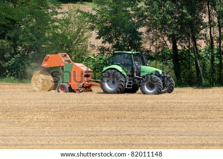 tractor with hay bales to catch the