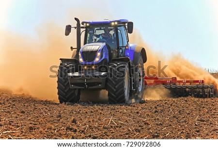 tractor working in the field. Tractor plow field Agriculture. Cultivated area. The concept of agronomy, agriculture, livestock.