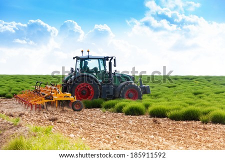 Tractor working on lavender fields - stock photo