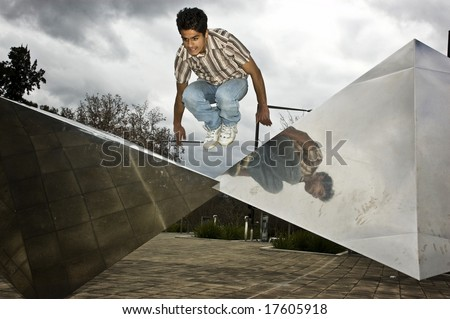 Tracuer takes vault over blocks - stock photo