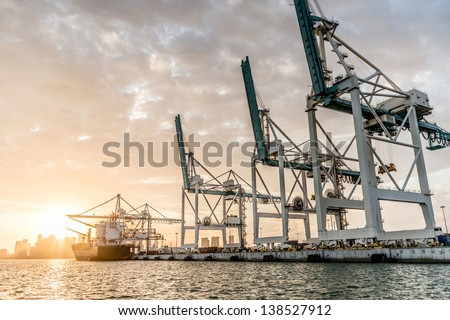Trade boat at the port of Miami - stock photo