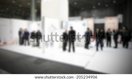 Trade show background, intentionally blurred post production - stock photo