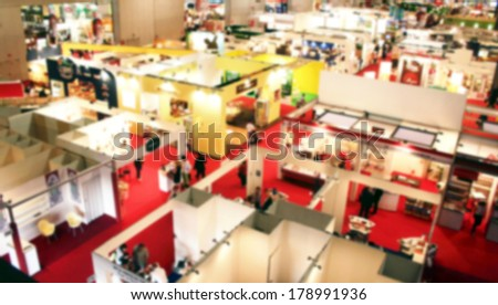 Trade show panoramic background, intentionally blurred post production - stock photo